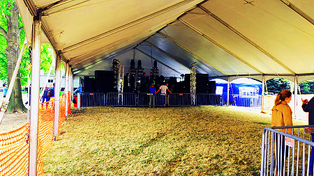 St Jude Event Stage for rent with skirting, stairs, tent roof, and sound