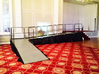 ADA stage ramp with rails